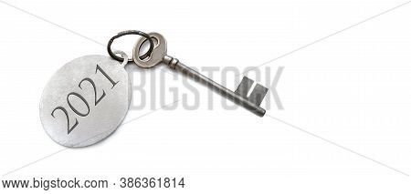 2021 Engraved On A Ring Of An Old Key On White Background