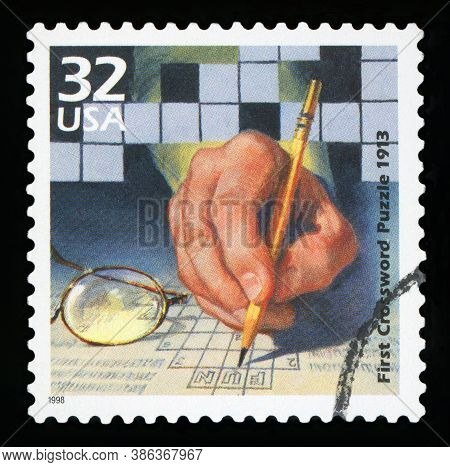 United States Of America - Circa 1998: A Stamp Printed In Usa Shows First Crossword Puzzle Published