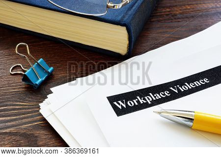 Workplace Violence Report Papers And Yellow Pen.