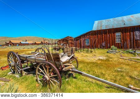 Rusty Wreck Of A Vintage Old Cart If Wood. Bodie State Historic Park, Californian Ghost Town Of The