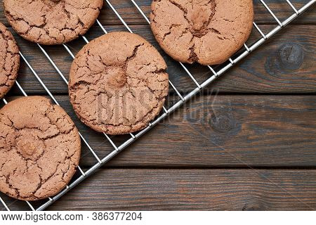 Top View Of Cookies On Baking Sheet And Wooden Background. Closeup