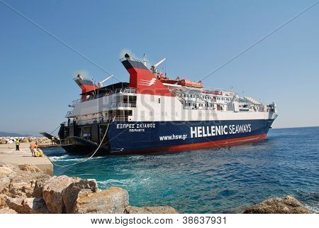 ALONISSOS, GREECE - SEPTEMBER 27, 2012: Hellenic Seaways ferry boat Express Skiathos docking at Patitiri harbour on September 27, 2012 at Alonnisos island, Greece. The ferry was built in 1996.