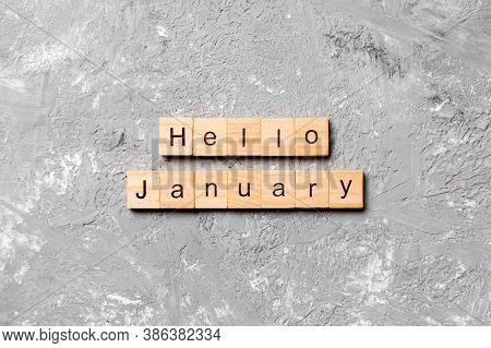 Hello January Word Written On Wood Block. Hello January Text On Table, Concept