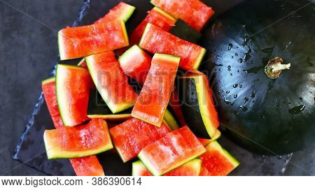 Watermelon And Watermelon Peels On A Dark Background. Eaten Watermelon. Selective Focus. Macro.