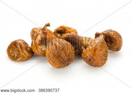 Preserved fruit. Group of dried figs isolated on white background.
