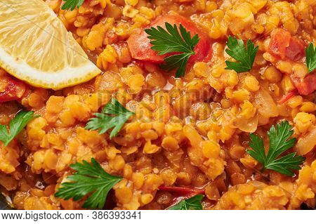 Red Lentils Dal Close Up. Lentils Tomato Dhal Is Indian Cuisine Dish With Lemon And Ciliantro. India