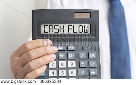 Cash Flow Word Text Inscription On Calculator In A Male Hand Of A Businessman In White Shirt And Blu