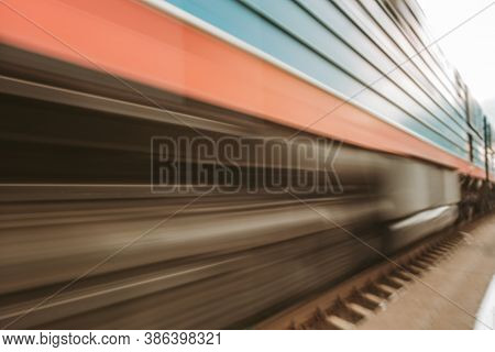 Blurry Background Of A High-speed Train With Blurry Traffic In The Air. The Speed Of The High-speed