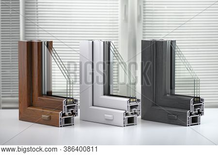 Plastic windows profile PVC of different colors in section on the table in office. 3d illustration