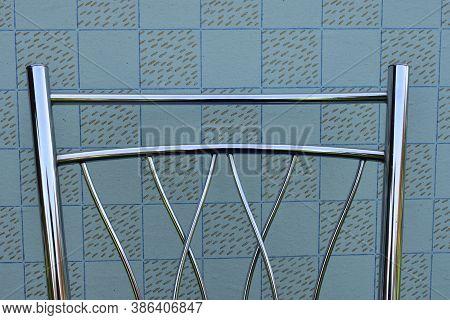 Backrest Of Modern Metal Chair On Vintage Wallpaper Background