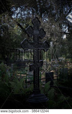 Black Grave Cross, Low Key, Twilight Twilight Nightfall Evening Night. Gloomy Scary Photo, Cemetery