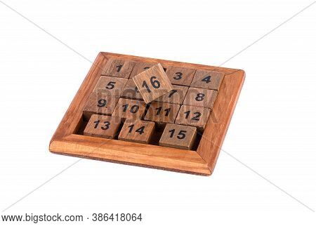 Game Of Fifteen - Wooden Sliding Puzzle Isolated On White Background. The Goal Of The Puzzle Is To A