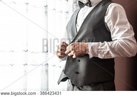 Grooms Morning Preparation, Handsome Groom Getting Dressed And Preparing For The Wedding, White Shir