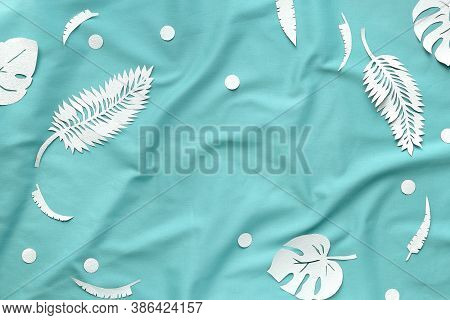 Ai Aqua - Trendy Color Of The Year 2021. Trendy Flat Lay, Exotic Leaves On Textile.