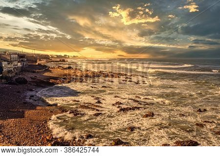 Dramatic Sunset Sky With Clouds Over The Wavy Sea. Moody Background. Nature Concept.