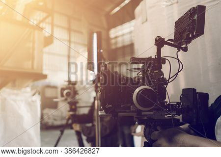 Video Production And Film Crew Team With Camera Equipment Indoor Location And Light Flare Effect. Vi