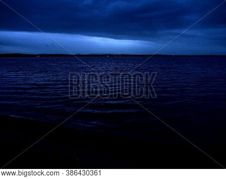 Dark Overcast Sky Over The Lake On A Summer Evening, Gloomy Clouds