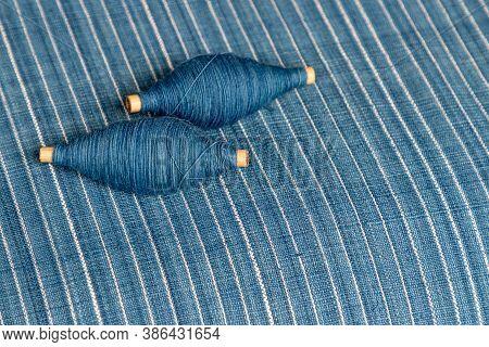 Indigo Dyed Yarn In Reel And Indigo Dyed Woven Fabric Background