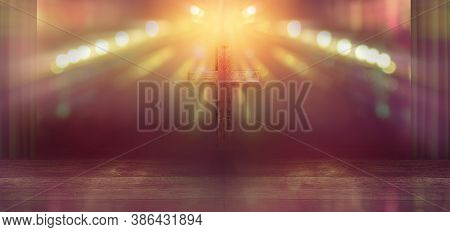 Wooden Cross On Stage With Light Rays In Blurred Bokeh Background, Christian Worship In Church