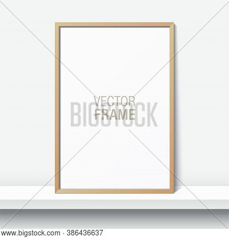 Simple Wooden Frame Standing On A Shelf. Blank Elegant Frame Leaning Against The White Wall. Picture