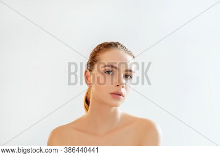Skin Treatment. Plastic Surgery. Portrait Of Sensual Woman With Nude Makeup Bare Shoulders Looking A
