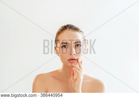 Lip Augmentation. Aesthetic Cosmetology. Portrait Of Sensual Woman With Perfect Skin Nude Makeup Bar