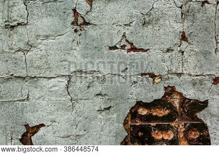 Cracked, Peeling White Paint With Spots On The Old Brick Wall. Old Weathered White Painted Stucco Pe