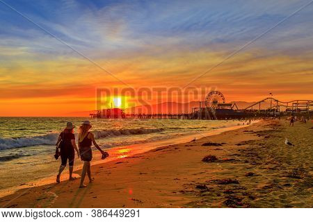 Santa Monica, California, Usa - August 8, 2018: Women Couple Walking At Sunset On Seashore Of Santa