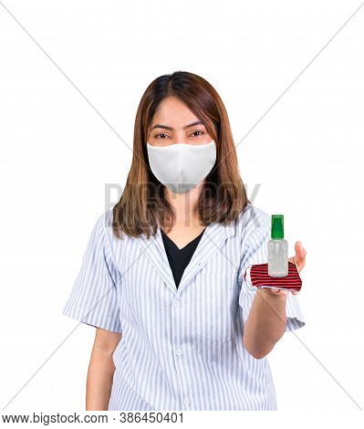 Woman Wearing Fabric Mask And Product Gel Antibacterial Antiseptic Place On Hand