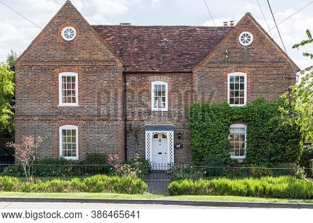 Quainton, Uk - May 15, 2020. Facade Of A Large Heritage House In Rural Buckinghamshire, Uk