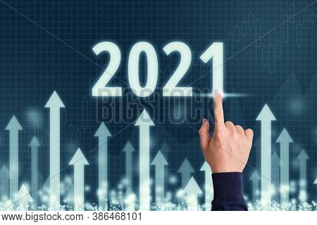 Concept For A Successful Year 2021 In Business With Abstract Upward Arrows