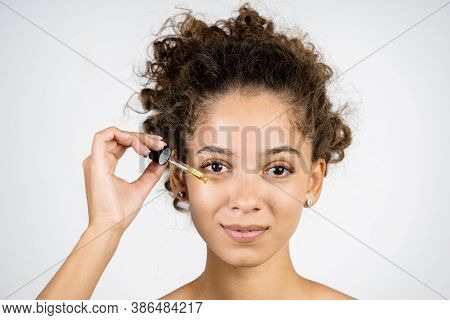 Concept Of Morning Routine Procedure. Face Portrait Of Beauty Adult African American Woman Holding P