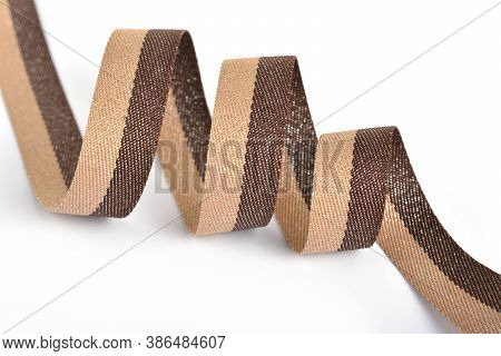Brown Beige Cotton Ribbon, Roll Textilies On Bobbin. Strapping Tape With Curl On White Backgroud. Us