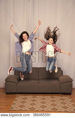 Celebrate Womens Day. Girls Only. Mom And Daughter Friends. Mother Cheerful Daughter Jumping Couch.