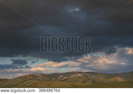 Gray Storm Clouds Over The Mountain. Autumn Landscape Before The Rain. Dark Blue Terrible Storm Clou