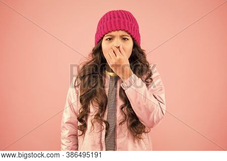 Flu Season. Sneezing. Cold Climate Weather. Little Girl Sick Ill Pink Background. Kid Puffer Jacket