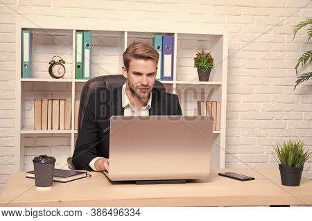 Starting Own Business. Businessman Drinking Coffee. Confident Man Use Laptop. Handsome Man In Busine