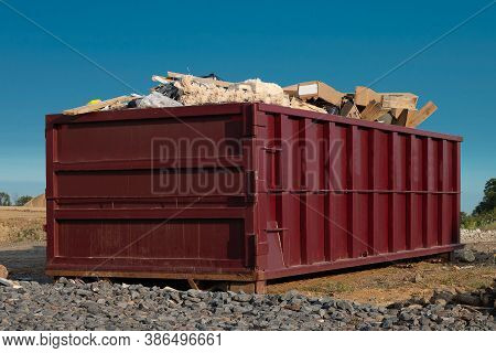 Construction Trash In Orange Large Steel Container Builders