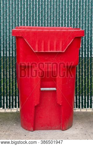 A Red Trash Bin For Students To Drop The Used Mask Inside