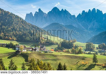 Landscape Of Early Autumn On The Church Santa Magdalena In Northern Italy On The Slopes Of The Dolom