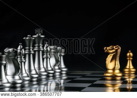 Leader.gold Horse Chess In Front Of Silver Chess Pawns Pieces On Chess Board Game Competition On Dar