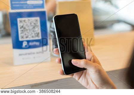5g. Customer Hand Using Digital Mobile Phone Scan Qr Code Pay Bill For Buying Food In Cafe Coffee Sh