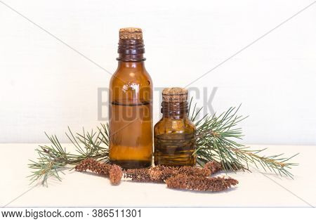 Bottles With Cedar Oil. Aromatherapy And Natural Cosmetics Concept