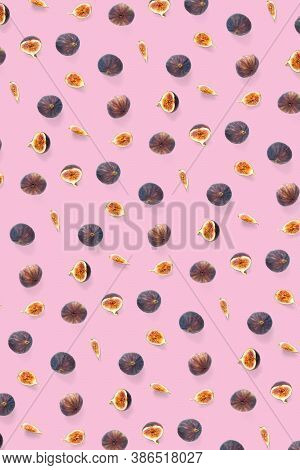 Background From Fresh Figs. Food Photo. Creative Set Of The Whole And Sliced Figs On A Pink Backgrou