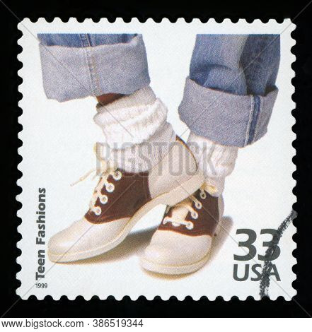 United States - Circa 1999: A Postage Stamp Printed In Usa Showing An Image Of Shoes And Legs Of A F
