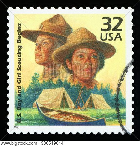 United States Of America - Circa 1998: A Stamp Printed In Usa Shows Boy Scouts Started In 1910, Girl