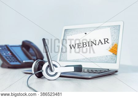 Webinar Text On Screen. Laptop On Desk. Business And Communications. Mockup Laptop And Voip Phone In