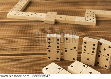 Domino. A Game Of Dominoes On A Wooden Table