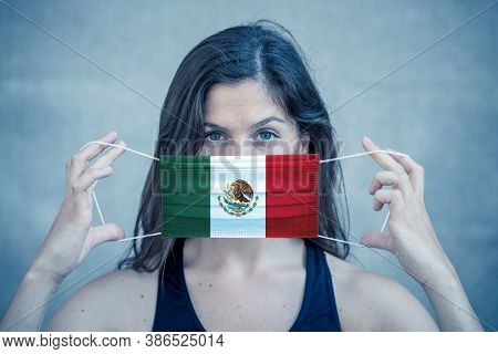 Coronavirus Outbreak In Mexico And Worldwide Health Crisis.woman Wearing Mexican Flag Face Mask Agai