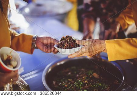Receiving Food For The Poor From Volunteers : Concepts Of Poverty